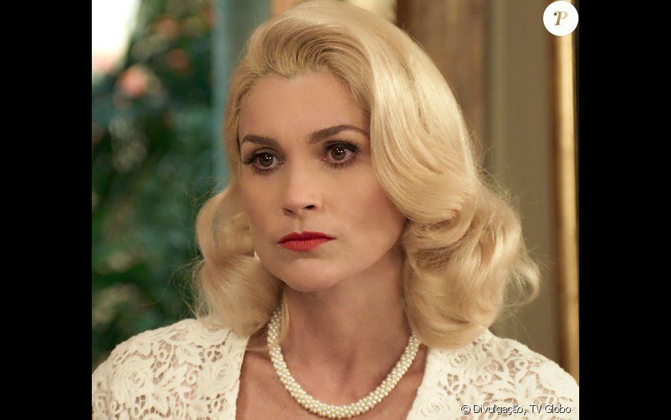 Sandra (Flávia Alessandra) é desmascarada no tribunal por Araújo (Flávio Tolezani) e vira fugitiva, na novela 'Êta Mundo Bom!', a partir de 9 de agosto de 2016