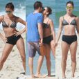 Fernanda de Freitas faz alongamento de biquíni e beija namorado na praia
