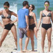 Fernanda de Freitas faz alongamento de biquíni e beija namorado na praia. Fotos!