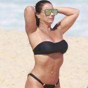 Viviane Araújo, de cabelo escuro para nova novela, se bronzeia na praia. Fotos!