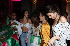 De barriga à mostra, Marquezine samba com bateria da Mangueira em evento de moda