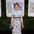 Keira Knightley escolheu um vestido romântico, com estampas de borboletas, para ir à premiação
