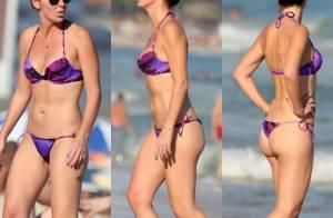 Aos 41 anos, Glenda Kozlowski exibe boa forma de biquíni em praia do Rio