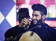 Solteiro, Gusttavo Lima comemora 26 anos lançando DVD em SP e bebe no palco