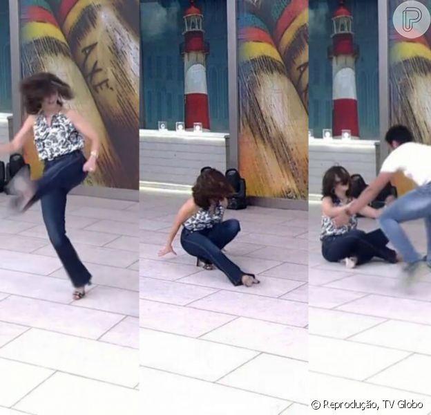 Fátima Bernardes levou tombo ao tentar jogar capoeira no 'Encontro', desta quinta-feira, 26 de novembro de 2015