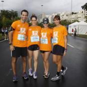 Juliano Cazarré e Monique Alfradique participam de corrida em dia frio no RJ