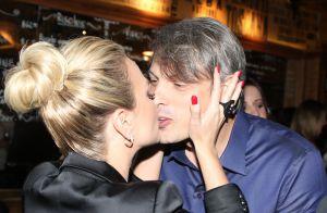 Eliana beija o namorado, Adriano Ricco, ao lançar loja virtual em SP. Fotos!