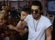 Luan Santana lança clipe em comunidade do Rio e come churrasquinho com farofa