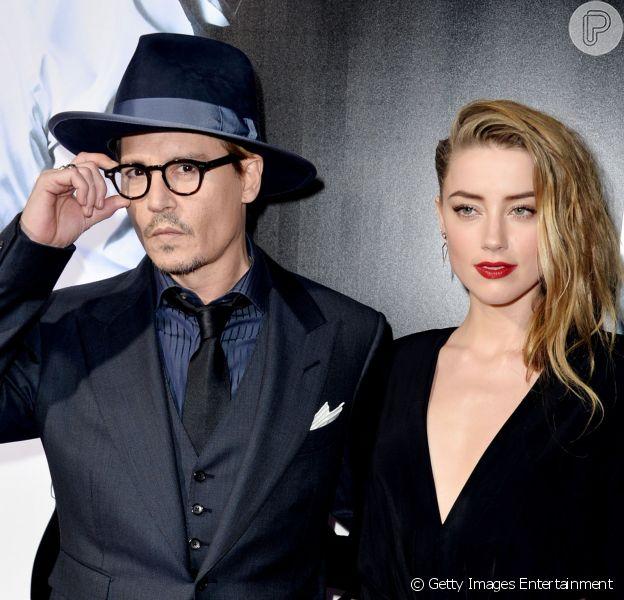 Johnny Depp e Amber Heard fizeram uma festa de noivado, em Los Angeles, na Califórnia, em 14 de março de 2014