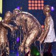 David Beckham toma banho de tinta dourada ao lado dos filhos Romeo e Cruz no prêmio Nickelodeon Kids' Choice Sports Awards