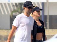 Fiorella Mattheis pratica exercício em praia do Rio com o namorado. Fotos!
