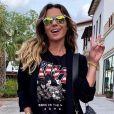 Giovanna Antonelli usa short em look de inverno. Atriz combina look com óculos espelhado colorido