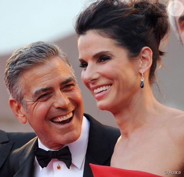 Sandra Bullock e George Clooney chamaram a atenção no Festival de Veneza em 28 de agosto de 2013