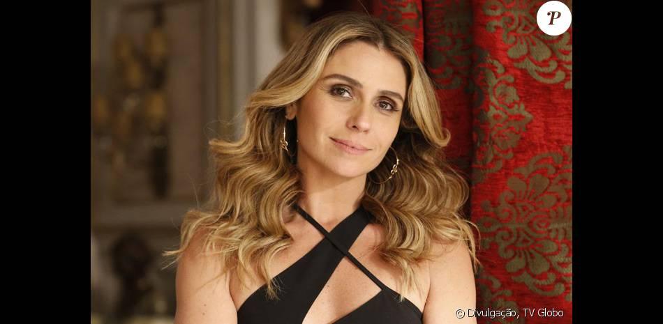 Atena (Giovanna Antonelli) é recebida de volta na facção por Gibson (José de Abreu) e exige salário de R$50 mil, na novela 'A Regra do Jogo', em fevereiro de 2016