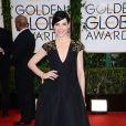 Julianna Marguliesusou um vestido da grife Andrew GN no Globo de Ouro 2014