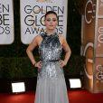 Mila Kunisusou um vestido da grife Gucci no Globo de Ouro 2014