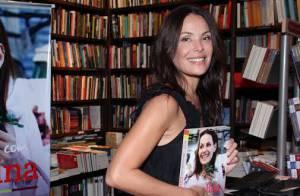 Carolina Ferraz beija o namorado em noite de autógrafos de seu livro no Rio