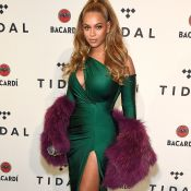 O look de Beyoncé: decote, superfenda e clutch 'rolo de dinheiro'. Saiba preço!