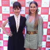 Alessandra Negrini e Deborah Secco combinam vestido e sock boots em pré-estreia
