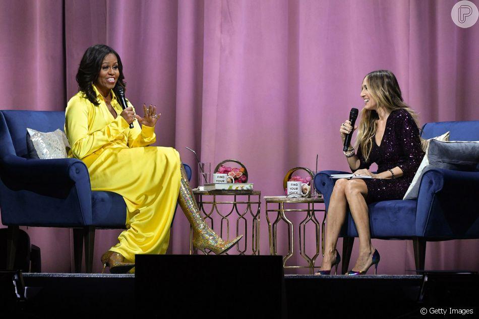 Botas holográficas: Michelle Obama + Sarah Jessica Parker em Nova York