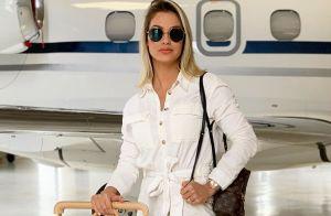 Andressa Suita elege calça de vinil e cropped grifado para show de Gusttavo Lima
