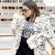 Anitta surpreende em look de frio durante viagem nesta quarta-feira, dia 10 de julho de 2019