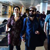 Letícia Sabatella embarca ao lado do marido em aeroporto do Rio