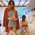 Giovanna Ewbank fez agachamentos com a filha, Títi, nas costas