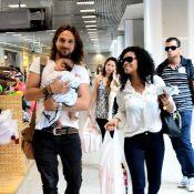 Igor Rickli circula com filho, Antônio, no colo em aeroporto no Rio de Janeiro