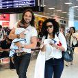 Igor Rickli e Aline Wirley embarcam com o filho Antônio no aeroporto Santos Dumont, no Rio de Janeiro