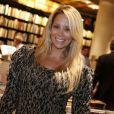 Danielle Winits, feliz na vida pessoal, não descarta ter um filho com o namorado, Amaury Nunes. Atriz conversou com a colunista Patricia Kogut, do jornal carioca 'O Globo', em 4 de abril de 2013