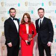Henry Cavill posou ao lado de Chris Evans e Julianne Moore, vencedora do prêmio de melhor atriz no  British Academy of Film   and Television Arts Awards 2015 (BAFTA)
