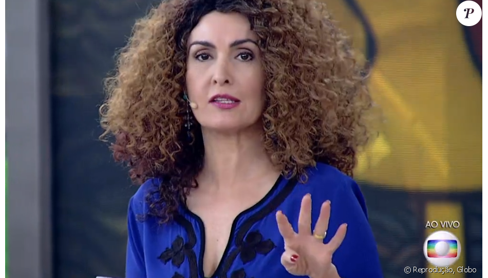 Fátima Bernardes  apostou em uma peruca com os cabelos cacheados no 'Encontro' desta terça-feira, 14 de junho de 2016