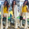 Izabel Goulart também foi criativa ao usar a camisa da Seleção Brasileira com uma calça flare e um blazer
