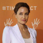 Angelina Jolie e Daniel Day-Lewis são condecorados pela rainha Elizabeth