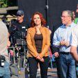 Scarlett Johansson adotou um visual ruivo para seu papel em 'Os vingadores'. Foto no set de filmagens, em 2011