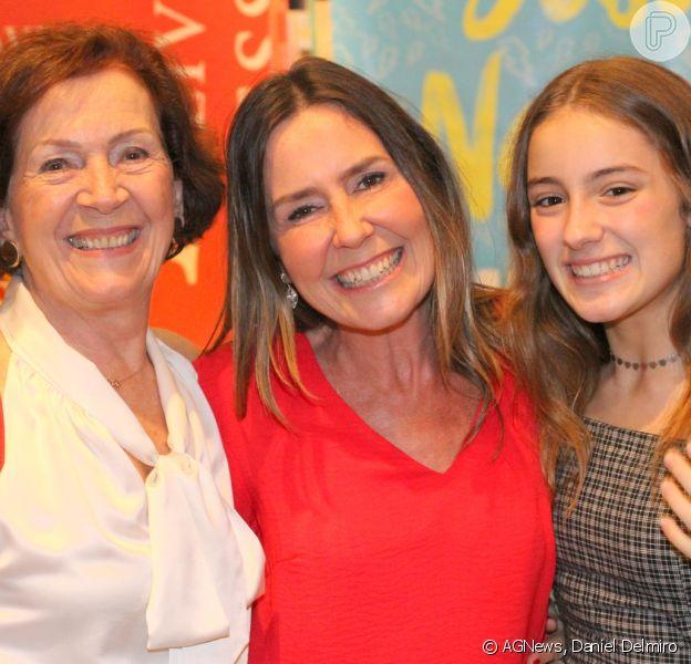 Susana Naspolini impressionou pela semelhança com a mãe e a filha, Júlia, de 13 anos, ao lançar sua biografia nesta quinta-feira, 27 de junho de 2019