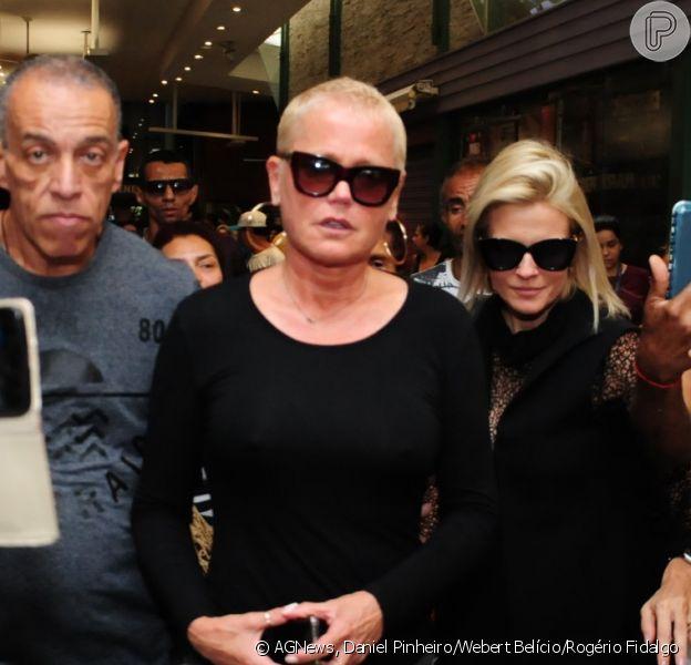 Xuxa, Luciano Huck e Angélica causaram tumulto ao chegarem e ao deixarem o velório do ator e diretor Jorge Fernando