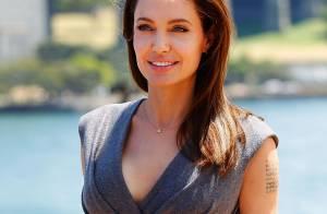 Angelina Jolie exibe cintura fina em pré-estreia de 'Invencível' na Austrália
