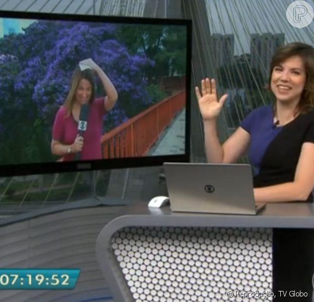 Glória Vanique brincou com Ananda Apple, que foi surpreendida por chuva, no 'Bom Dia São Paulo', desta sexta-feira, 20 de fevereiro de 2015: 'Ai, a chapinha'