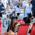A família Mader ficou sentada em cadeiras de praia, perto da orla da praia do Leblon