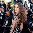 A atriz austríaca Coco König apostou em um vestido transparente com aplicação de flores e borboletas para a cerimônia de abertura da 70ª edição do Festival de Cannes, no sul da França, nesta quarta-feira, 17 de maio de 2017