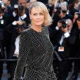Robin Wright, do seriado 'House of Cards', apostou em um vestido curto Yves Saint Laurent para a cerimônia de abertura da 70ª edição do Festival de Cannes, no sul da França, nesta quarta-feira, 17 de maio de 2017