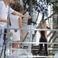 Claudia Leitte acenou com bandeira de Fórmula 1 em cima do trio