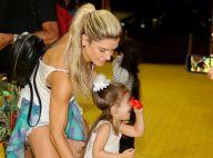 Valentina, filha de Mirella Santos, se diverte com nariz de palhaço em circo