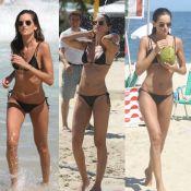 Izabel Goulart mergulha, toma ducha e bebe água de coco em praia no RJ. Fotos!