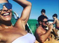 Juliana Paes elogia marido em foto na praia com os filhos: 'Fica sexy comendo'
