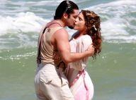 Isabella Santoni e Bruno Gissoni se beijam em gravação de novela na praia. Fotos