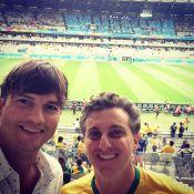 Ashton Kutcher faz selfie com Luciano Huck no Mineirão antes de jogo do Brasil