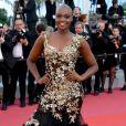 Miriam Odemba optou por uma boca vermelha alaranjada para o Festival de Cannes 2018